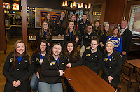 The Gilford High School 2015 State Championship Volleyball team is welcomed to McDonalds by Brand Ambassador Larry Johnston for a celebratory breakfast on Saturday morning.  (l-r front row) Sydney Holland, Michaela Ralls, Emily Theberge, Maddie Currier, Stevie Orton and Maddie Harris  (middle row) Karly Sanborn, Lexi Boisvert, Bailey Hildreth, Erin Gately, Coach Joan Forge and Brand Ambassador Larry Johnston.  (back row) Shannon Mercer, Jordan Dean, Brooke Beaudet, David Hart and Cynthia Gagnon.  (Karen Bobotas/for the Laconia Daily Sun)