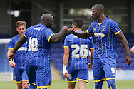 Adebayo Akinfenwa scores and Celebrates with Tom Elliott during the Pre-Season Friendly match between AFC Wimbledon and Cheltenham Town at the Cherry Red Records Stadium, Kingston, England on 1 August 2015. Photo by Stuart Butcher.