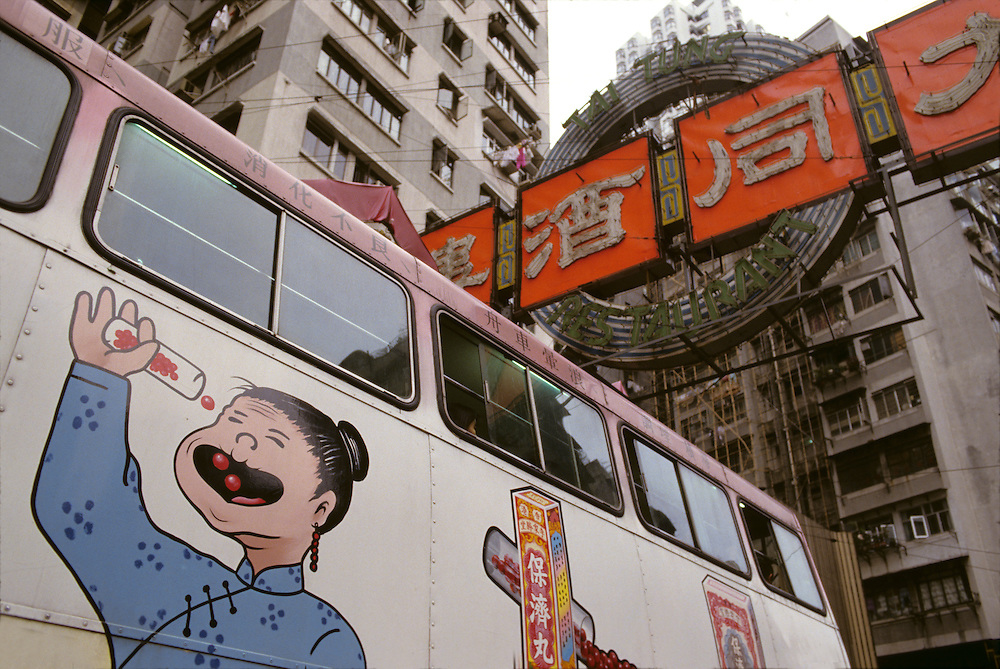 China, Hong Kong, Candy advertisement on side of city bus