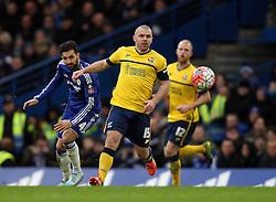 Cesc Fabregas of Chelsea flicks the ball past Stephen Dawson of Scunthorpe United - Mandatory byline: Robbie Stephenson/JMP - 10/01/2016 - FOOTBALL - Stamford Bridge - London, England - Chelsea v Scunthrope United - FA Cup Third Round