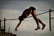 """Kyle Wessel '14 from Missouri University pole vaults during the 2011 Kip Janvrin Open at Simpson College on Friday, narrowly brushing against the bar at a height of 4.70m (15' 5"""")."""