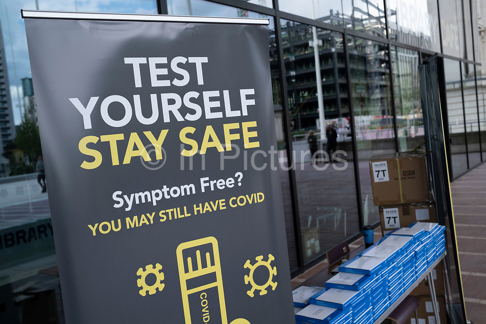 Free NHS test and trace lateral flow testing kits being given out in the city centre on 3rd August 2021 in Birmingham, United Kingdom. Rapid lateral flow self testing kits are for people who do not have symptoms of coronavirus / COVID-19 and give a quick result.