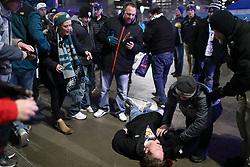 February 4, 2018 - Minneapolis, MN, USA - A man lays unconscious on the ground during a fight as fans left U.S. Bank Stadium after Super Bowl LII on Sunday, Feb. 4, 2018 in Minneapolis, Minn. (Credit Image: © Anthony Souffle/TNS via ZUMA Wire)