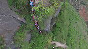 LIANGSHAN, CHINA - MAY 14: (CHINA OUT) <br /> <br />  Pupils from Atuler village climb vines hung on the cliff to go home after school on May 14, 2016 in Liangshan Yi Autonomous Prefecture, Sichuan Province of China. 72 families lived in Atuler village on the 800-meter cliff at Meigu River Canyon in Liangshan Yi Autonomous Prefecture. 15 pupils, aged 6 to 15, accompanied by 3 adults regularly spent 2 hours climbing 17 vines ladders hung on the 800-meter-high cliff to go between school and home twice a month. Villagers used the same ladders to go to the nearest market once a week to sell peppers and walnuts and buy necessities.<br /> ©Exclusivepix Media
