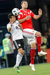 June 19, 2018 - Saint Petersburg, Russia - Artem Dzyuba (R) of Russia national team and Tarek Hamed of Egypt national team vie for a header during the 2018 FIFA World Cup Russia group A match between Russia and Egypt on June 19, 2018 at Saint Petersburg Stadium in Saint Petersburg, Russia. (Credit Image: © Mike Kireev/NurPhoto via ZUMA Press)