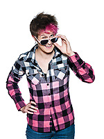 one funny young stylish woman with dye pinkhair and a bleached shirt looking over pink sunglasses