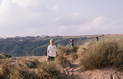 Children playing in the sand dunes,
