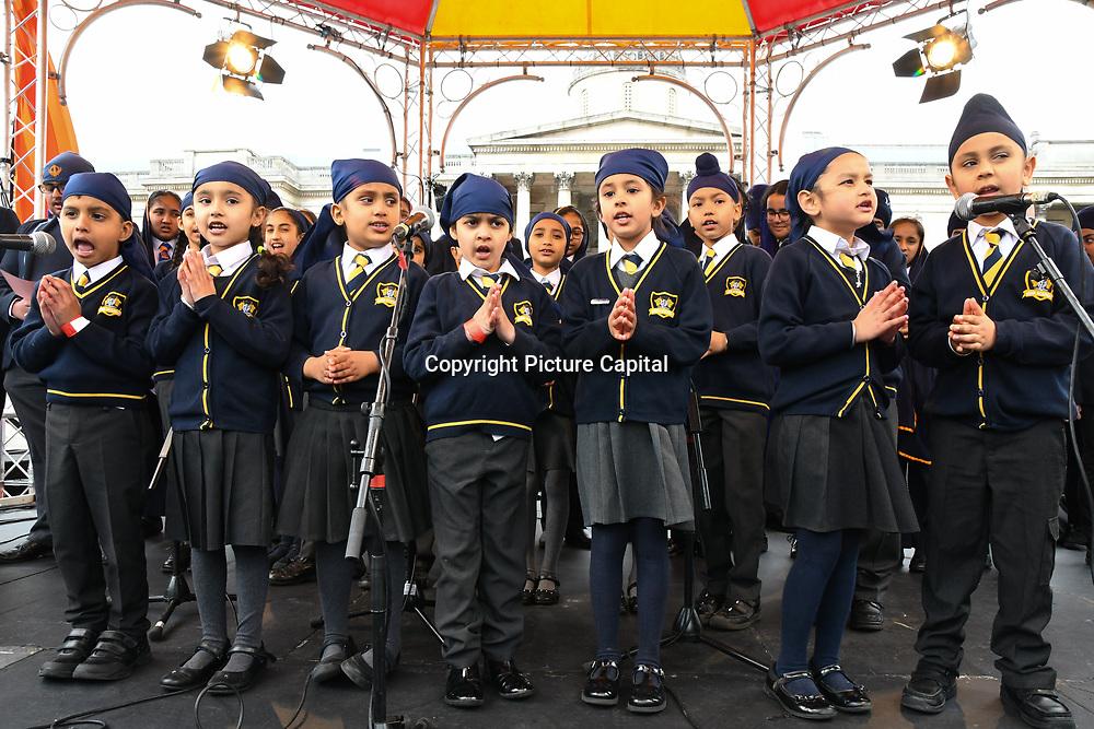London, England, UK. 27 April 2019. Khalsa Trust Academy , Children's music performance at the Vaisakhi Festival is a Sikh New Year in Trafalgar Square, London, UK.