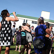 Race goers in party mood during a day at the Races at Ascot Park, Invercargill, Southland, New Zealand. 10th December 2011. Photo Tim Clayton
