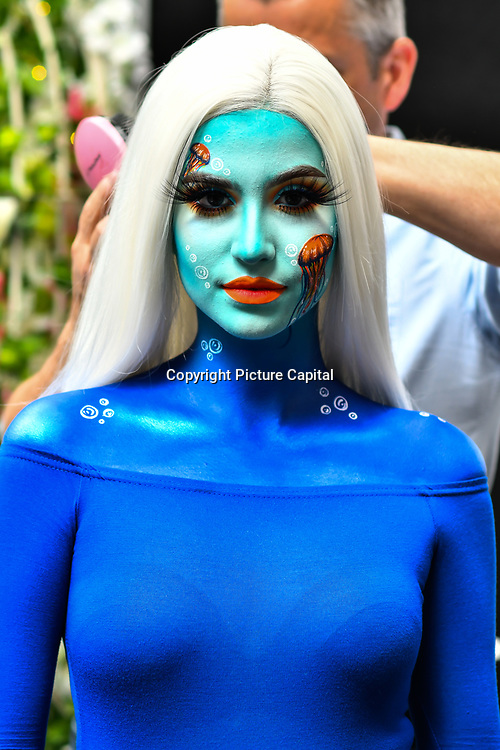 Artist Abby Roberts is to create a jellyfish illusion and ocean scene using a mix of make-up and body paint using Eldora False Eyelashes demo at IMATS on 18 May 2019,  London, UK.