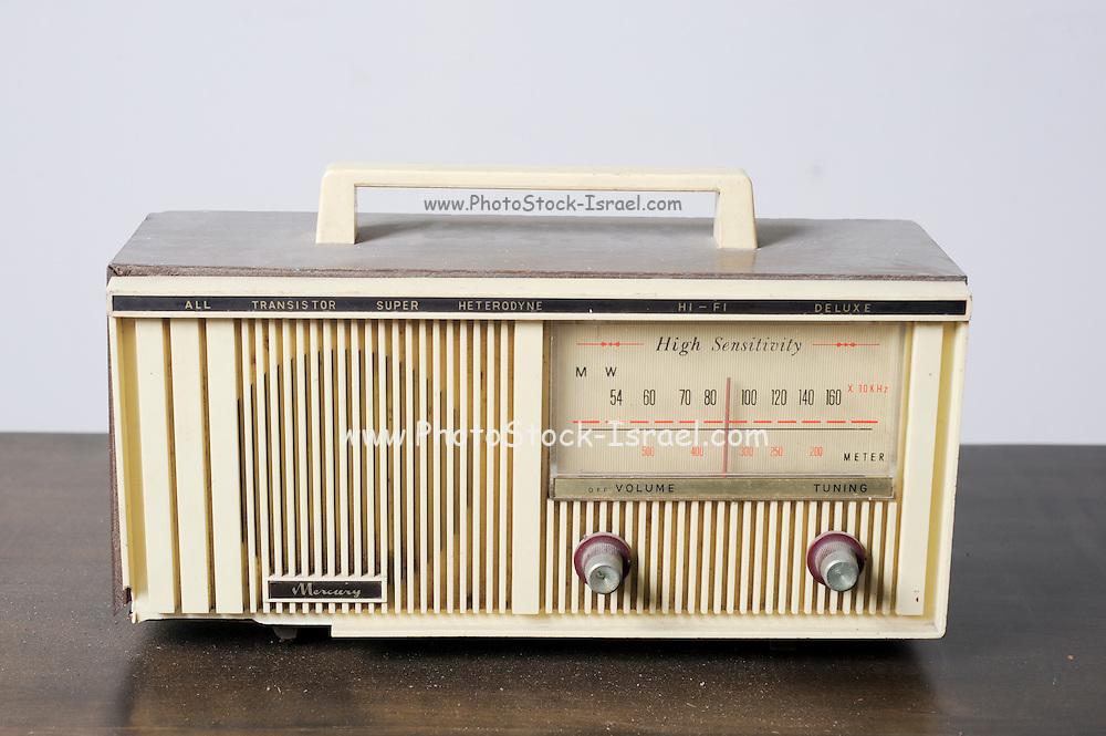 Cutout of a retro Mercury transistor radio receiver on white background