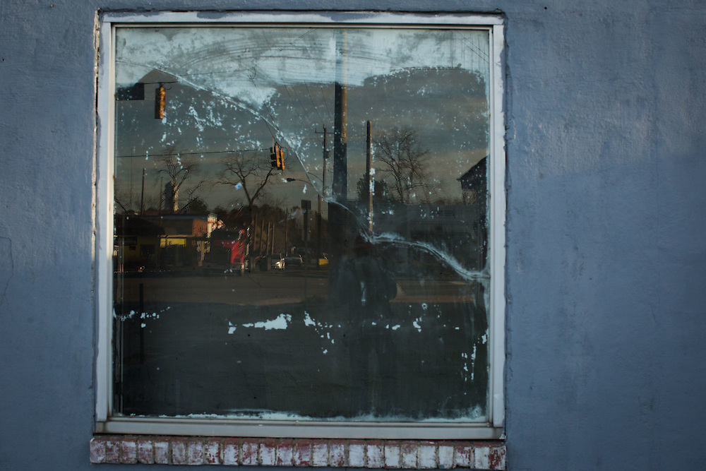 Downtown Pearson , Ga. is reflected in the window of a closed business on Thursday, March 3, 2016. Photo by Kevin D. Liles for The New York Times