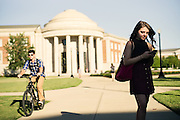 TUSCALOOSA, AL – SEPTEMBER 28, 2016: Jillian Mazon checks her phone on the way back to her college dorm room. Despite the rising cost of college tuition nationwide, in state student enrollment is becoming less profitable for major public universities. In response to these financial shortfalls, flagship universities around the country are working hard to rebrand themselves as attractive institutions for out of state students. The University of Alabama has begun an aggressive campaign to recruit out of state students, as the revenue from those students is much greater. CREDIT: Bob Miller for The New York Times