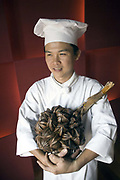 Sous Chef Tong Phuoc Duc holds a toddy palm in the Square One restaurant of the Saigon Hyatt Hotel, Ho Chi Minh City, Vietnam