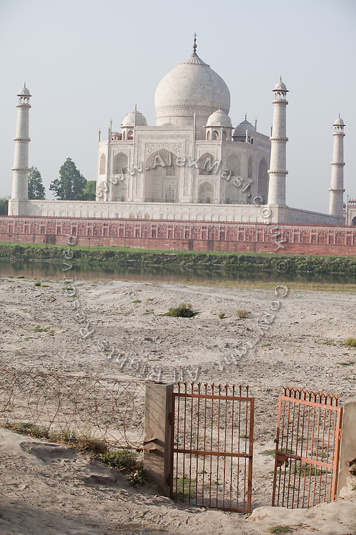 The heavily polluted Yamuna River is almost dry in summer, allowing flying sands to reach the Taj Mahal, in Agra.