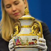 LONDON, ENGLAND - MAY 22:  An employee of the Royal Collection with a  mounted vase dating 1779 part of the Sevres  exhibition that will open May 23rd. This vase purcased by HM the Queen is part of a group of three originally purchased by Marie Antoniette. on May 22, 2009 in London, England.  (Photo by Marco Secchi/Getty Images)
