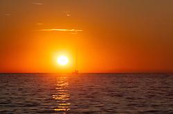 THEMENBILD - URLAUB IN KROATIEN, ein Boot fährt dem Sonnenuntergang entgegen, aufgenommen am 03.07.2014 in Porec, Kroatien // a boat travels into the sunset at Porec, Croatia on 2014/07/03. EXPA Pictures © 2014, PhotoCredit: EXPA/ JFK