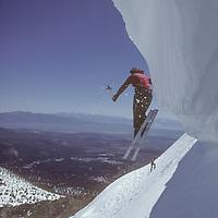 Lois Rice jumping cornice by Dave's Run, Mammoth Mountain, CA.