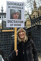 Some protesters outside Parliament in London accuse Prime Minister Theresa May of being a dictator. London, January 15 2019.
