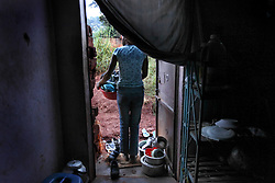 Phiona Mutesi, a 14-year-old chess prodigy, at home inside Katwe, the largest slum in Kampala, Uganda, Dec. 10, 2010. Mutesi lives in the slums of Uganda and is just now learning to read. She never knows when her mother will return and is left to care for her siblings. But her instincts have made her a player to watch in international chess. Mutesi, a naturally talented chess player is coached by Robert Katende of Sports Outreach Ministry. The chess club meets at the Agape Church.