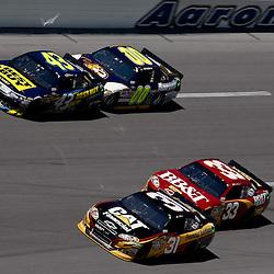 April 17, 2011; Talladega, AL, USA; NASCAR Sprint Cup Series driver Jeff Burton (31) leads Clint Bowyer (33), A.J. Allmendinger (43), David Reutimann (00) during the Aarons 499 at Talladega Superspeedway.   Mandatory Credit: Derick E. Hingle