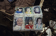 Central America, Honduras, Tegucigalpa. Family photo album amidst ruins. Devastation in the aftermath of Hurricane Mitch. High winds and flooding. Photo albums children. Infrastructure destroyed.
