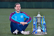 Peter Haring (#5) of Heart of Midlothian FC poses with the Scottish Cup during the Heart of Midlothian press conference, media and training session, ahead of the William Hill Scottish Cup Final, at the Oriam Sports Performance Centre, Edinburgh, Scotland on 15 December 2020.<br /> <br /> *** EMBARGOED UNTIL 16/12/2020 ***