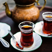 Turkish tea served in an old copper teapot. Tea is ubiquitous in Turkey and is drunk throughout the day.