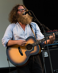 © Licensed to London News Pictures. 09/07/2013. London, UK.   Ben Caplan performing live at Kew Gardens , supporting headliner Blondie.  Ben Caplan is a Canadian singer songwriter with influences including Tom Waits, gypsy and blues.   Photo credit : Richard Isaac/LNP