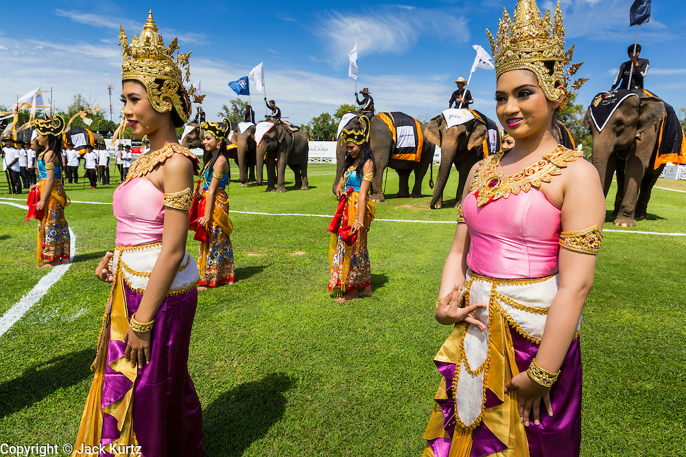 """28 AUGUST 2013 - HUA HIN, PRACHUAP KHIRI KHAN, THAILAND:  Traditional Thai dancers perform at the opening of the King's Cup Elephant Polo Tournament in Hua Hin, Thailand. The tournament's primary sponsor in Anantara Resorts and the tournament is hosted by Anantara Hua Hin. This is the 12th year for the King's Cup Elephant Polo Tournament. The sport of elephant polo started in Nepal in 1982. Proceeds from the King's Cup tournament goes to help rehabilitate elephants rescued from abuse. Each team has three players and three elephants. Matches take place on a pitch (field) 80 meters by 48 meters using standard polo balls. The game is divided into two 7 minute """"chukkas"""" or halves. There are 16 teams in this year's tournament, including one team of transgendered """"ladyboys.""""    PHOTO BY JACK KURTZ"""