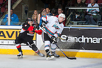 KELOWNA, CANADA - MARCH 9: Chase Witala #8 of Prince George Cougars checks Rourke Chartier #14 of Kelowna Rockets during first period on March 9, 2016 at Prospera Place in Kelowna, British Columbia, Canada.  (Photo by Marissa Baecker/Shoot the Breeze)  *** Local Caption *** Rourke Chartier; Chase Witala;