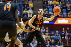 Jan 12, 2019; Morgantown, WV, USA; Oklahoma State Cowboys guard Thomas Dziagwa (4) passes the ball during the first half against the West Virginia Mountaineers at WVU Coliseum. Mandatory Credit: Ben Queen-USA TODAY Sports
