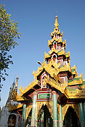 A temple at the Shwedagon pagoda, the most sacred pagoda in the country, in the capital of Yangon (Rangoon), Myanmar