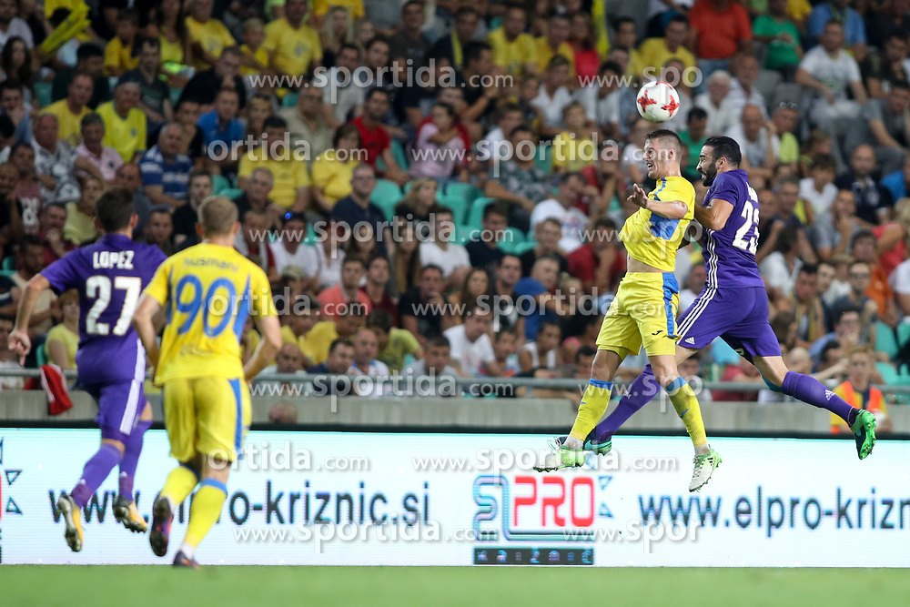 Lovro Bizjak of NK Domzale and Adil Rami of Olympic Marseille during football match between NK Domzale and Olympique de Marseille in First game of UEFA Europa League playoff round, on August 17, 2017 in SRC Stozice, Ljubljana, Slovenia. Photo by Morgan Kristan / Sportida