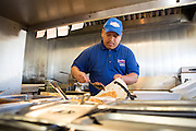 Bernardo Garcia adds rice, beans, and other toppings to a steak burrito at Taqueria Las Vegas in Milpitas, Calif., on Sept. 20, 2012.  Photo by Stan Olszewski/SOSKIphoto.
