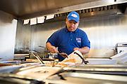 Bernardo Garcia adds rice, beans, and other toppings to a steak burrito at Taqueria Las Vegas in Milpitas, Calif., on Sept. 20, 2012.  Photo by Stan Olszewski/SOSKIphoto.