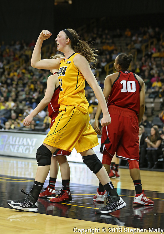 February 11 2013: Iowa Hawkeyes center Morgan Johnson (12) is pumped up after making a basket and getting fouled by Nebraska Cornhuskers forward Meghin Williams (10) during the second half of the NCAA women's basketball game between the Nebraska Cornhuskers and the Iowa Hawkeyes at Carver-Hawkeye Arena in Iowa City, Iowa on Monday, February 11 2013.