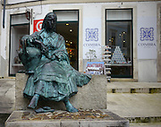Monument to the singers of the old town, the Tricana of Coimbra. The statue is in the Almedina district of Coimbra, Rua do Quebra-Costas, Coimbra, Portugal