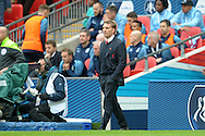 Brendan Rodgers, the Liverpool manager looks on from the touchline. The FA Cup, semi final match, Aston Villa v Liverpool at Wembley Stadium in London on Sunday 19th April 2015.<br /> pic by John Patrick Fletcher, Andrew Orchard sports photography.
