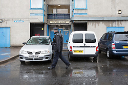 © Licensed to London News Pictures. 26/07/2015. London, UK. A police officer walks past Clewer House in Wolvercote Road in Bexley, south east London. A teenager has died after a party in Clewer House, Wolvercote Road where he was believed to have taken laughing gas (nitrous oxide). Photo credit : Vickie Flores/LNP