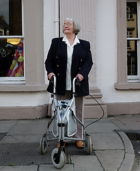 © Licensed to London News Pictures. <br /> 10/07/2014. <br /> <br /> Durham, United Kingdom<br /> <br /> Nora Newby, 80, from Chilton has been one of the first people to stand on the route of Durham Miners Gala. This year is her 59th year of coming to the Durham Miners Gala as she waits patiently for the colliery brass bands to pass by.<br /> <br /> The Gala, or Durham Big Meet as it is known locally began in 1871 and today many hundreds of people still meet up in the market place of the city which is the start of the parade. <br /> <br /> The colliery brass bands and banners are followed by those with allegiance to those former colliery villages and they march from there to the cities Racecourse. As they pass the County Hotel on Old Elvet they walk past union leaders, invited guests and local dignitaries who greet the march from the hotel balcony.<br /> <br /> Photo credit : Ian Forsyth/LNP
