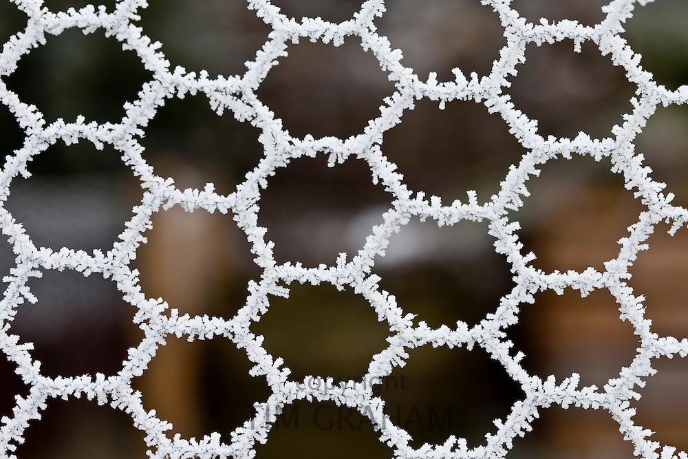 Winter scene hoar frost on wire fencing