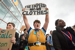13 December 2019, Madrid, Spain: As COP25 is about to draw to a close, hundreds of young people mobilize through Fridays for Future in a strike for the climate, inside and outside the venue of COP25 in Madrid, calling for urgent action for climate justice. Here, Saoirse O'Connor holds a sign reading 'The Emperor has no Clothes'.