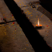 Diya (oil lamp) burning at the steps of the Main ghat