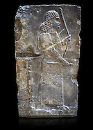 Stone relief sculptured panel of an archer. Inv AO 19885 from Dur Sharrukin the palace of Assyrian king Sargon II at Khorsabad, 713-706 BC.  Louvre Museum Room 4 , Paris .<br /> <br /> If you prefer to buy from our ALAMY PHOTO LIBRARY  Collection visit : https://www.alamy.com/portfolio/paul-williams-funkystock/ancient-assyria-antiquities.html  Refine search by adding background colour, place, subject, museum etc into the LOWER SEARCH WITHIN GALLERY box to <br /> <br /> Visit our ANCIENT ASSYRIAN PHOTO COLLECTIONS for more photos to download or buy as wall art prints https://funkystock.photoshelter.com/gallery-collection/Ancient-Assyrian-Art-Artefacts-Antiquities-Historic-Sites-Pictures-Images-of/C0000cjRqQyJjLag