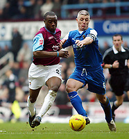 Fotball<br /> Championship 2004/05<br /> West Ham v Cardiff<br /> 6. februar 2005<br /> Foto: Digitalsport<br /> NORWAY ONLY<br /> Nigel Reo-Coker of West Ham tussles for the ball with Graham Kavanagh of Cardiff City
