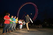 Andrew Mehrtens of New Zealand kicks an Official Rugby World Cup match ball into the London Eye as the other rugby legends look on. RWC 2015, Coca Cola London Eye launch for the Rugby World cup event  in London on Tuesday 15th Sept  2015.<br /> pic by John Patrick Fletcher, Andrew Orchard sports photography.