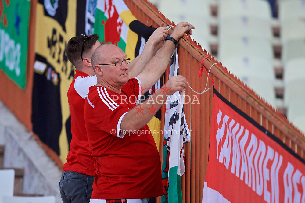 BELGRADE, SERBIA - Sunday, June 11, 2017: Wales supporters put up their flags before the 2018 FIFA World Cup Qualifying Group D match between Wales and Serbia at the Red Star Stadium. (Pic by David Rawcliffe/Propaganda)