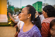 """29 JANUARY 2013 - PHNOM PENH, CAMBODIA:   Mourners gather in front of the Royal Palace in Phnom Penh, Cambodia during the mourning period for Norodom Sihanouk. Sihanouk (31 October 1922- 15 October 2012) was the King of Cambodia from 1941 to 1955 and again from 1993 to 2004. He was the effective ruler of Cambodia from 1953 to 1970. After his second abdication in 2004, he was given the honorific of """"The King-Father of Cambodia."""" Sihanouk held so many positions since 1941 that the Guinness Book of World Records identifies him as the politician who has served the world's greatest variety of political offices. These included two terms as king, two as sovereign prince, one as president, two as prime minister, as well as numerous positions as leader of various governments-in-exile. He served as puppet head of state for the Khmer Rouge government in 1975-1976. Most of these positions were only honorific, including the last position as constitutional king of Cambodia. Sihanouk's actual period of effective rule over Cambodia was from 9 November 1953, when Cambodia gained its independence from France, until 18 March 1970, when General Lon Nol and the National Assembly deposed him. Upon his final abdication, the Cambodian throne council appointed Norodom Sihamoni, one of Sihanouk's sons, as the new king. Sihanouk died in Beijing, China, where he was receiving medical care, on Oct. 15, 2012. His cremation is scheduled to take place on Feb. 4, 2013. Over a million people are expected to attend the service.     PHOTO BY JACK KURTZ"""