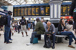 July 5, 2018 - London, London, UK - London, UK. Passengers wait at London Victoria, where there is significant disruption to train services. Commuters have been advised not to travel after a major power loss which is expected to continue throughout the day. (Credit Image: © Rob Pinney/London News Pictures via ZUMA Wire)